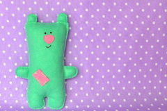 Cute green felt Teddy bear. Children toy. Background with copy space for text Royalty Free Stock Photo