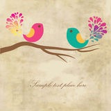 Cute greetings card with birds on a swing Stock Photo