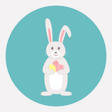 Cute grey rabbit with Easter eggs Royalty Free Stock Photos