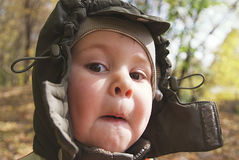 Cute, grimacing little boy Stock Images