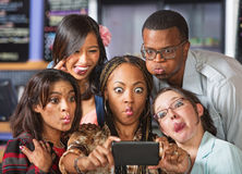 Cute Group Making Faces Stock Image