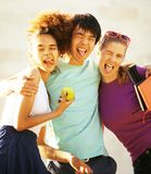 Cute group of teenages at the building of university with books Royalty Free Stock Images