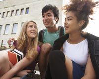 Cute group teenages at the building of university Stock Images
