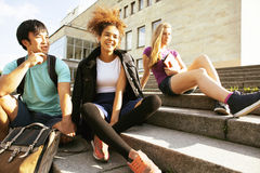 Cute group teenages at the building of university with books huggings Stock Image