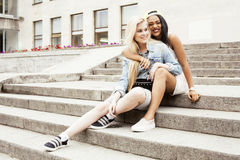 Cute group of teenages at the building of university with books huggings, back to school, lifestyle happy people concept. Cute group of teenages at the building Stock Images
