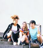 Cute group of teenages at the building  university with books huggings, back to school stock image