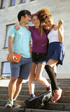 Cute group of teenages at the building of university with books huggings, back to school Royalty Free Stock Photography