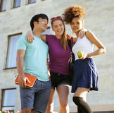 Cute group of teenages at the building of university with books huggings, back to school Royalty Free Stock Image