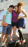 Cute group of teenages at the building of university with books huggings, back to school Stock Images