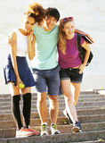 Cute group of teenages at the building of university with books huggings, back to school Royalty Free Stock Images