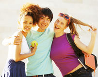 Cute group of teenages at the building of university with books huggings Royalty Free Stock Photo