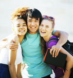 Cute group of teenages at the building of university with books huggings Royalty Free Stock Image