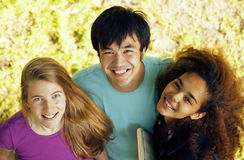 Cute group teenages at the building of university Stock Image
