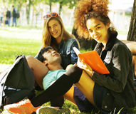 Cute group teenages at the building of university with books huggings, diversity nations Stock Photos