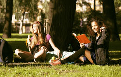 Cute group of teenages at the building of university with books huggings, diversity nations Royalty Free Stock Images