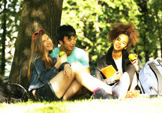 Cute group of teenages at the building of university with books Stock Photo