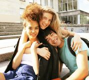 Cute group of teenages at the building of university with books Stock Image
