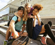 Cute group teenages at the building of university Royalty Free Stock Image