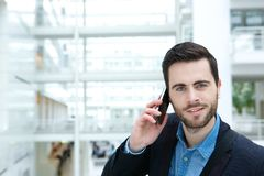 Cute guy calling by mobile phone Royalty Free Stock Photography