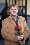 Cute guy and flowers Stock Photography