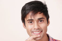 Cute guy grinning Stock Photography