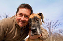 Cute guy and great dane looking at camera Royalty Free Stock Images