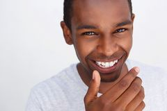 Cute guy laughing with hand covering mouth Stock Images