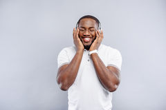 Cute guy listening to wonderful melody Royalty Free Stock Photo