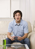 Cute guy playing video game Royalty Free Stock Photos