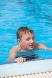 Cute guy in the pool. Summer day Stock Photo