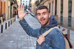 Cute guy saying hi outdoors stock image