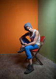 Cute guy sits in chair Royalty Free Stock Photography