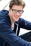 Cute guy smiling with glasses Royalty Free Stock Photography