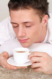 Cute guy with tea Stock Photography