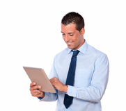 Cute guy working with his tablet pc Royalty Free Stock Photography