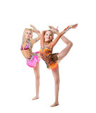Cute gymnasts perform vertical split synchronously Royalty Free Stock Photo