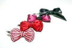 Cute hair bows in a row. Four cute hair bows in a row royalty free stock photography
