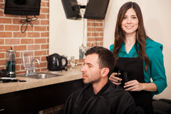 Cute hairstylist at work Royalty Free Stock Photo