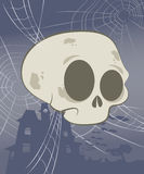 Halloween Skull Scene. Cute Halloween skull suspended by spider webs Royalty Free Stock Images