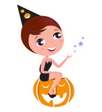 Cute Halloween Witch Girl sitting on Pumpkin head. Royalty Free Stock Image