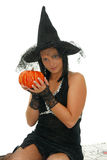 Cute halloween witch. With pumpkin isolated on white background Stock Images
