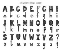 Cute hand drawn alphabet. Vector letters set. Scandinavian style with decorations.  royalty free illustration