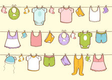 Cute hand drawn baby clothes Stock Images