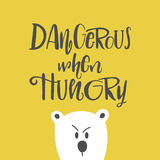 Cute hand drawn cartoon illustration with lettering dangerous when hungry. Stock Photo