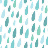 Cute hand drawn doodle seamless pattern with blue rain drops Royalty Free Stock Image