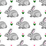 Cute hand drawn hares and flowers seamless pattern. Cute hand drawn little hares and flowers seamless pattern Royalty Free Stock Photo