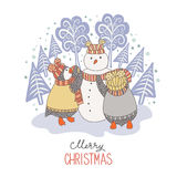 Cute hand drawn penguins making a snowman Royalty Free Stock Photography