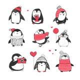 Cute hand drawn penguins set - Merry Christmas greetings Stock Photos