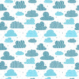 Cute hand drawn seamless pattern with clouds. Funny background f Stock Photo