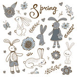 Cute hand drawn spring collection with rabbits and flowers Stock Photos